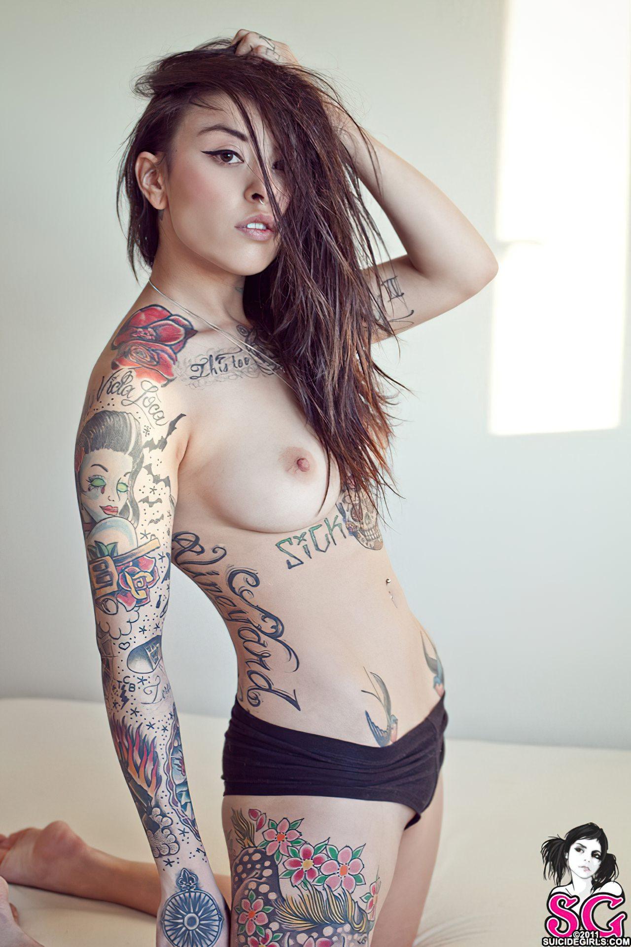 Mulher com Tatuagens